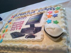 Nurses Week cake with computer and mouse on it
