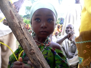 Beautiful little girl close up, living in Darfur refugee camp