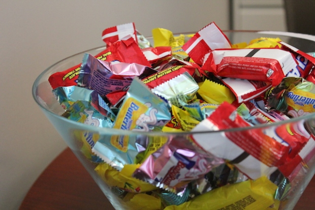 glass bowl of wrapped chocolates
